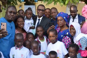 Youssou Ndour with men, women and children